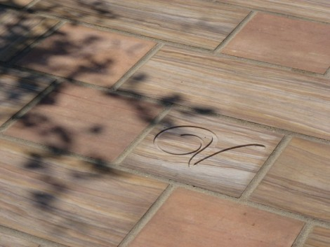 Rainbow sandstone paving with engraved 'V'