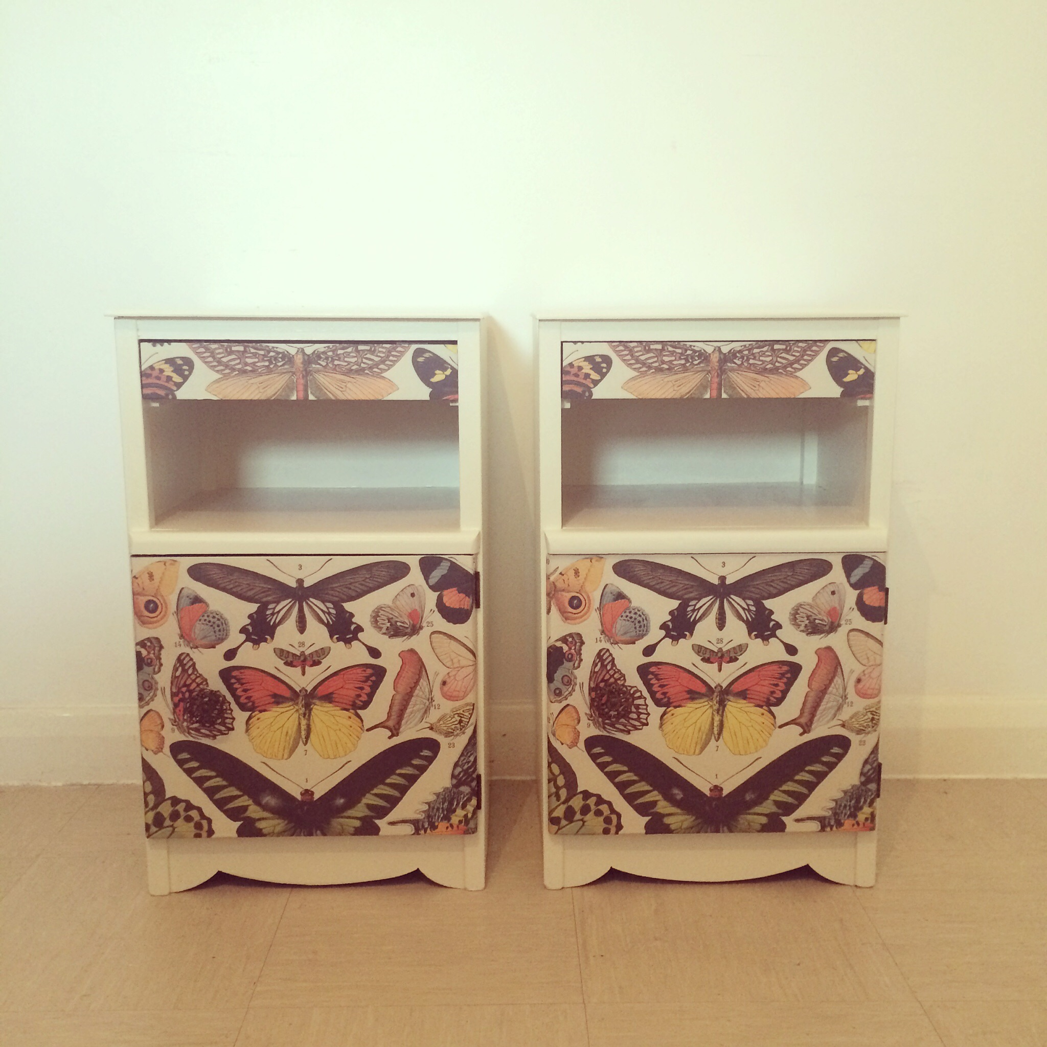 Upcycled butterfly charts bedside cabinets.