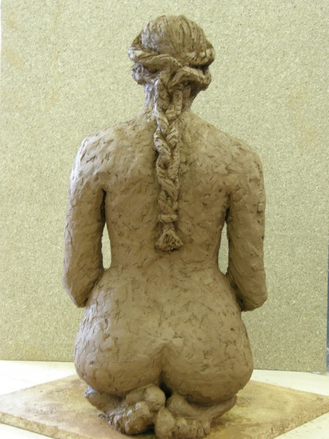 Kneeling woman with plait