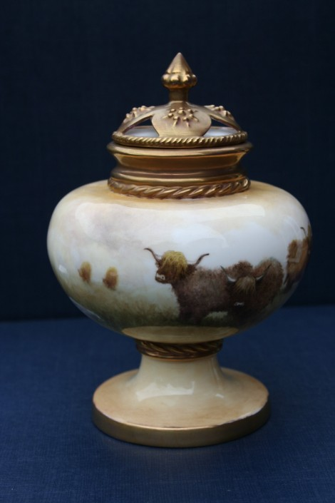 Ornate lidded round vase with pierced lid